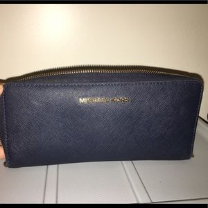 Navy blue Micheal Kors wallet.